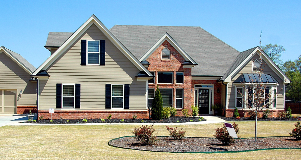 homeowners red brick house with landscaping