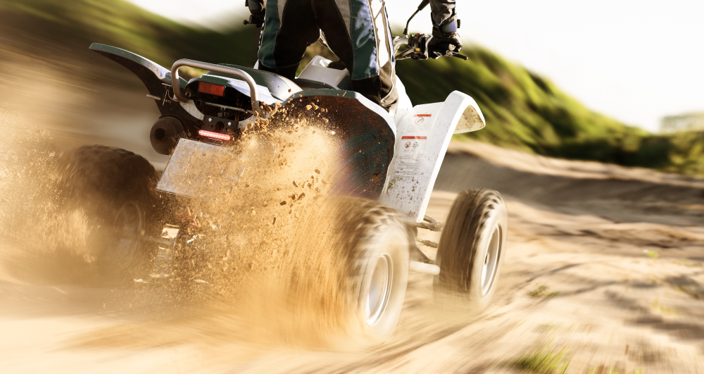 back-view-of-white-ATV-throwing-up-dirt
