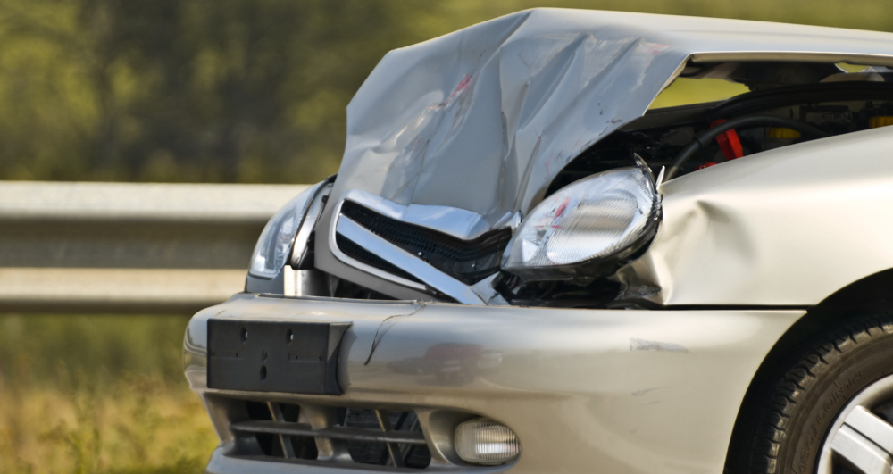 car-accident-with-front-end-damage-to-tan-colored-car