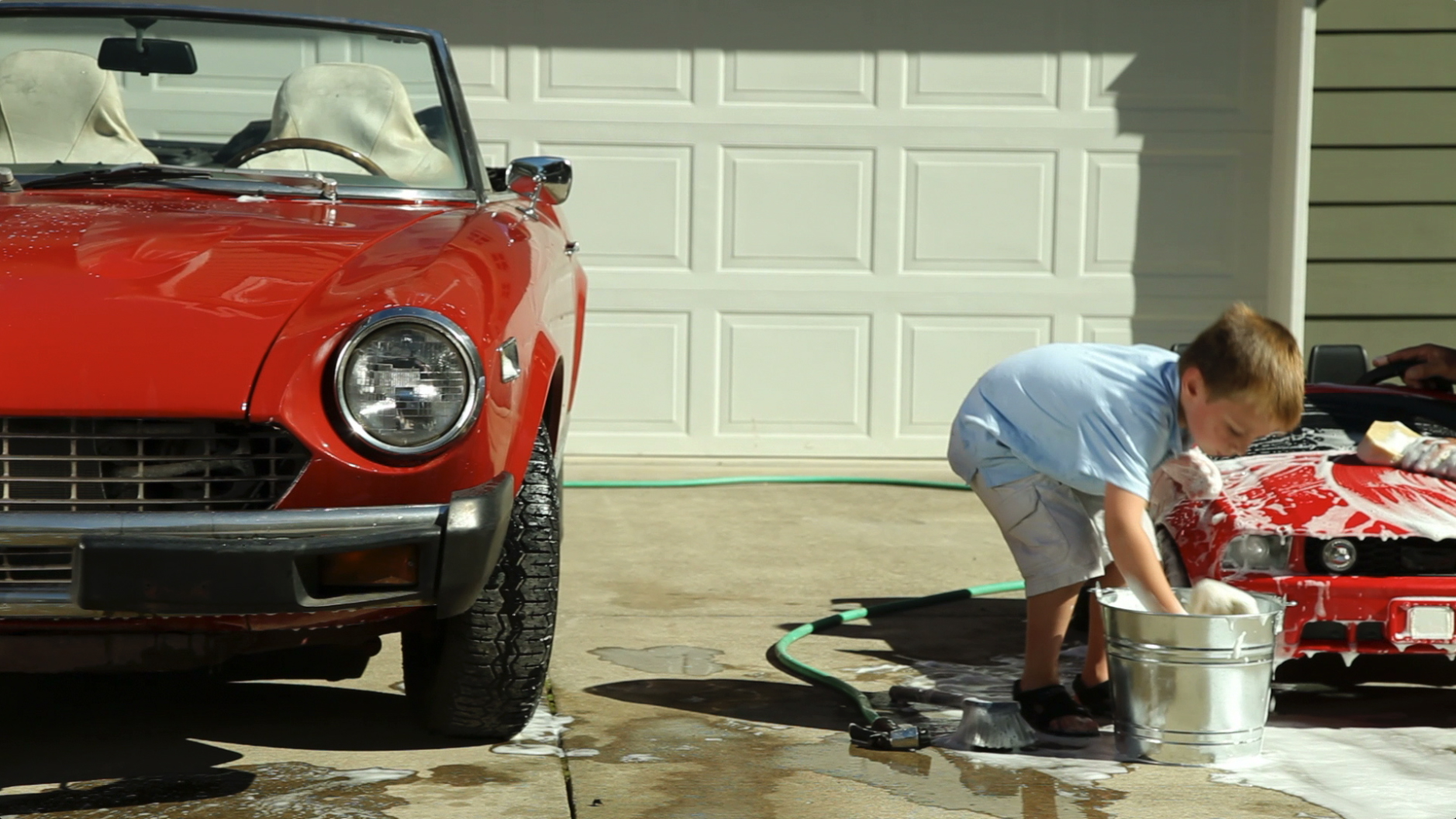 grandpa-grandson-washing-red-convertible-together---amana-insurance-agency